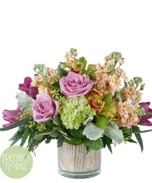 Low-profile flower arrangement, modern, trendy, chic with lavender roses and more.