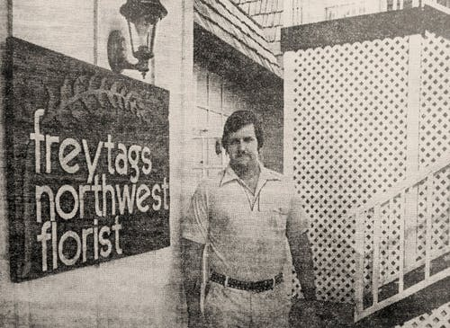 Photographed some time in the 1980s, Ken Freytag poses beside the sign outside his Texas flower shop